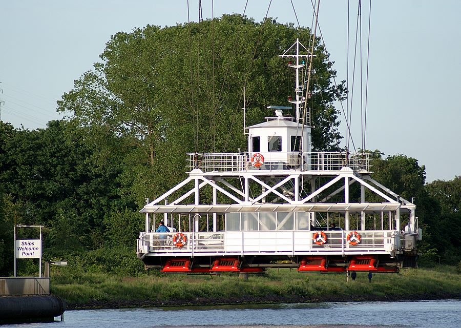 Ferry suspended from bridge